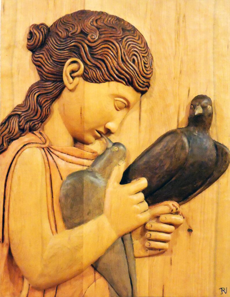 Niña con paloma. Alumno Escuela de Talla en madera Gubiarte